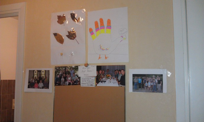 "I'll finish with an updated picture of our ""love wall,"" but now I have my parents' Christmas card up too!"