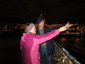 Gotta keep track of these crazy kids somehow.  Throwing the key into the Seine after putting their lock on the bridge.
