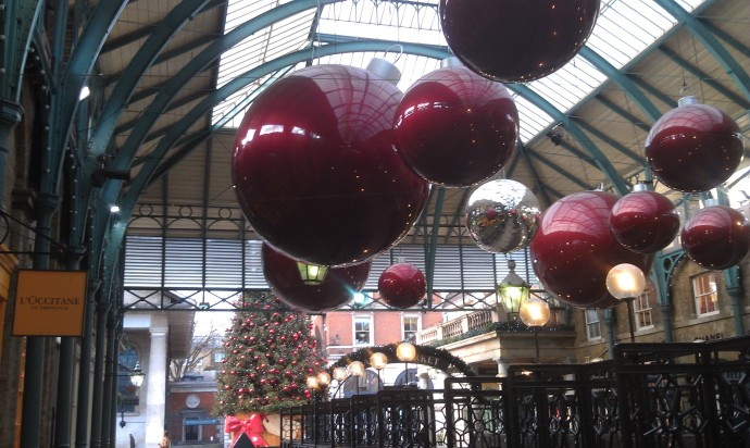 Some of the Christmas decorations in Covent Garden.  See that big Christmas tree in the back- I got my photo taken in front of that exact tree in November!