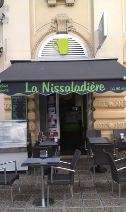 "In Italian, Nice is ""Nissa,"" and ""pissaladière"" is a specialty dish here in Nice.  A clever combination of the two words for a cafe!!"