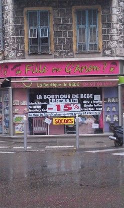 "Another clever one.  In French, girl is ""fille"" and boy is ""garçon"" - this is a baby store.  However, the street this is on is ""Rue Arson,"" hence the spelling of ""G'Arson""!"